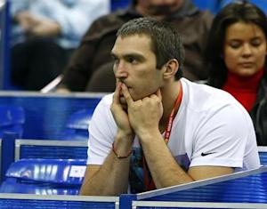Hockey player Ovechkin watches the match between Russia's Kirilenko and Sweden's Arvidsson during their Kremlin Cup tennis match in Moscow