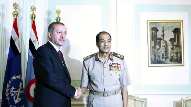 Field Marshal Mohamed Hussein Tantawi, head of Egypt's ruling military council, right, greets Turkish Prime Minister Recep Tayyip Erdogan, upon his arrival at the defence ministry in Cairo, Egypt, Tuesday, Sept. 13, 2011. Erdogan, intent on broadening Turkey's influence in the Middle East and the Arab world, started a visit to Egypt and will also visit Tunisia and Libya, two other countries where popular uprisings have ousted autocratic leaders. (AP Photo/Amr Nabil, Pool)