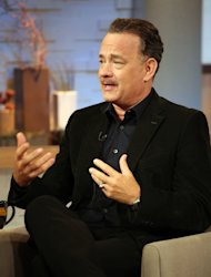 This image released by ABC shows actor Tom Hanks during an interview segment on &quot;Good Morning America,&quot; Friday, Oct. 19, 2012 in New York. ABC and Tom Hanks are apologizing after the actor let slip a swear word during a live appearance on Good Morning America. Hanks telegraphed his f-bomb during an interview Friday. Anchor Elizabeth Vargas had asked him to speak in his character&#39;s British accent in the movie Cloud Atlas. Hanks said that it was mostly swear words, but Vargas told him to go ahead anyway. He began speaking in a mumble but the obscenity was clearly audible. ABC removed it for subsequent feeds of the show in the Midwest and West. (AP Photo/ABC, Fred Lee)
