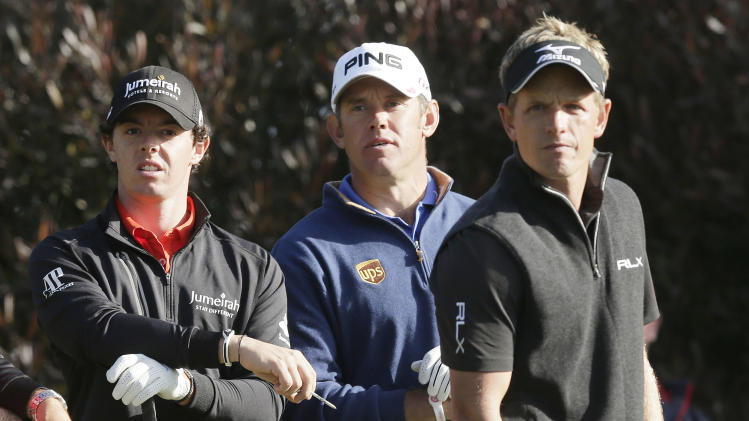 Rory McIlroy, of Northern Ireland, left to right, Lee Westwood, of England, and Luke Donald, of England, wait on the 17th tee during the first round of the U.S. Open Championship golf tournament Thursday, June 14, 2012, at The Olympic Club in San Francisco. (AP Photo/Charlie Riedel)