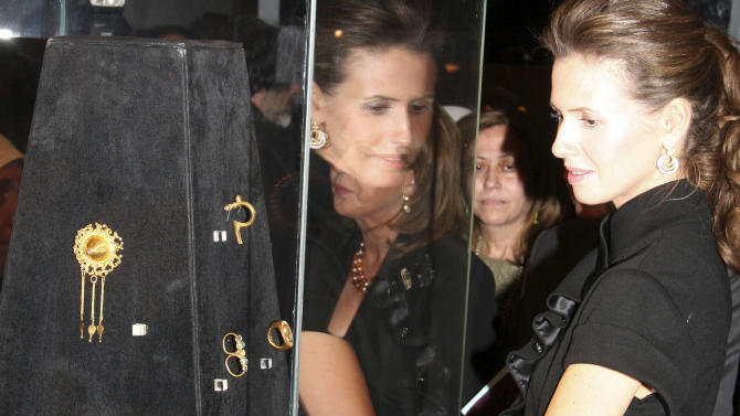 "FILE - In this Oct. 29, 2007 file photo, Asma Assad, the wife of Syrian President Bashar Assad, attends an exhibition at the National Museum in Damascus. The 20-day exhibition titled ""a sea of jewels,"" was organized by the Italian Institute of Culture in Damascus, the Directorate General of Antiquities and Museums of Syria and the National Archeological Museum of Naples. Syria's top antiquities official is calling for U.N. intervention and cooperation from neighboring countries to halt the illicit trafficking of its artifacts as the 23-month civil war rages on. (AP Photo Bassem Tellawi, File)"
