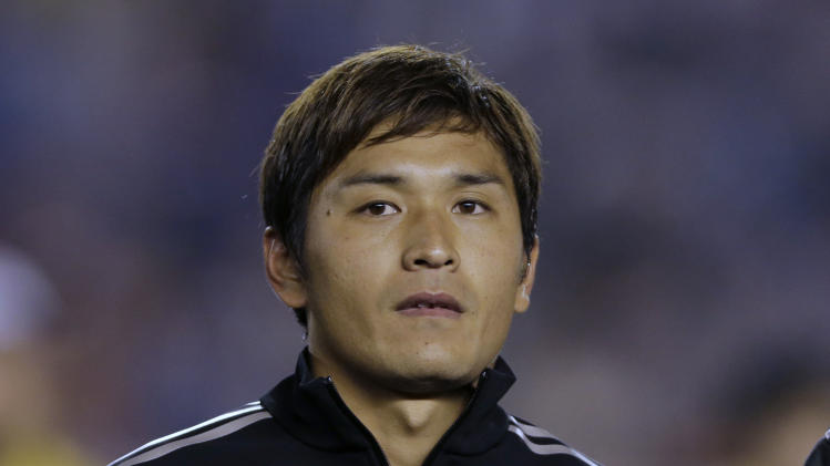 Japan's Toshihiro Aoyama poses on the pitch before the Kirin Challenge Cup international friendly soccer match against New Zealand in Tokyo, Wednesday, March 5, 2014. (AP Photo/Shuji Kajiyama)
