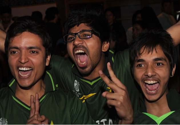 Pakistani cricket fans react to their team's victory as they watch the Asia Cup final match between Pakistan and Bangladesh on a giant screen on March 22, 2012 in Karachi. Pakistan recorded a thrillin