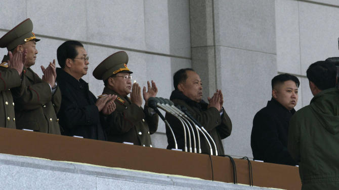 """FILE - In this Dec. 17, 2012 file photo, North Korean leader Kim Jong Un, right, and his uncle Jang Song Thaek, second from left, attend a ceremony to reopen the Kumsusan Palace of the Sun in Pyongyang, North Korea. North Korea announced Monday, Dec. 9, 2013 it had sacked leader Jang, long considered the country's No. 2 power, saying corruption, drug use, gambling, womanizing and generally leading a """"dissolute and depraved life"""" had caused Pyongyang's highest-profile fall from grace since Kim took power two years ago. Others are unidentified. (AP Photo/Ng Han Guan, File)"""