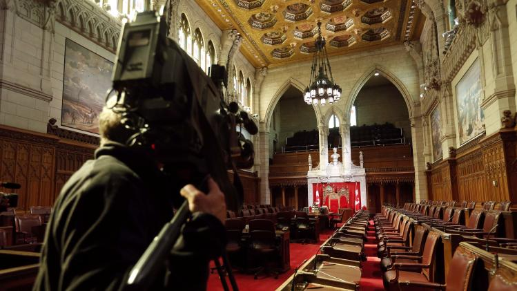 A cameraman films the Senate Chamber on Parliament Hill in Ottawa