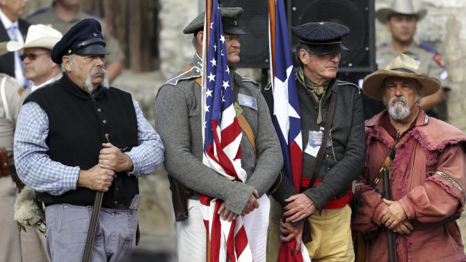 The William Barret Travis Letter, requesting help to defend the Alamo, returned to the Alamo for the first time since it was sent in 1836. Friday, Feb. 22, 2013 in San Antonio.  Reenactors stand guard waiting for the historic document to arrive. (AP Photo/San Antonio Express-News, Bob Owen)  RUMBO DE SAN ANTONIO OUT; MAGS OUT; NO SALES; MANDATORY CREDIT