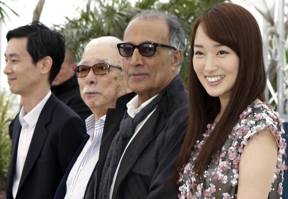 From left actors, Ryo Kase, Tadashi Okuno, director Abbas Kiarostami and actress Rin Takanashi pose during a photo call for Like Somone in Love at the 65th international film festival, in Cannes, southern France, Monday, May 21, 2012. (AP Photo/Lionel Cironneau)