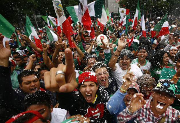 Fans of Mexico&#39;s soccer team celebrate after their team beat Brazil in the men&#39;s soccer final at the London 2012 Summer Olympics, below the Angel of Independence monument in Mexico City, Saturday, Aug. 11, 2012. Mexico won the match 2-1 and the gold.(AP Photo/Marco Ugarte)