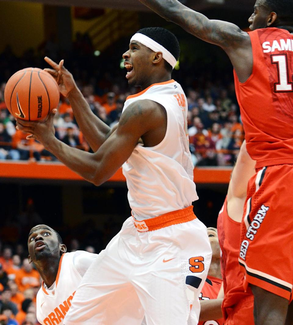 Syracuse's C.J. Fair shoots against St. John's during the second half of an NCAA college basketball game in Syracuse, N.Y., Sunday, Feb. 10, 2013. Syracuse won 77-58. (AP Photo/Kevin Rivoli)