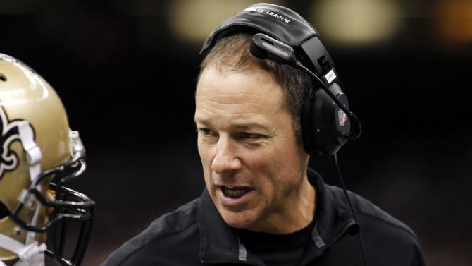 FILE - In this Sept. 23, 2012 file photo, New Orleans Saints acting head coach Aaron Kromer talks in the second half of an NFL football game against the Kansas City Chiefs  at the Mercedes-Benz Superdome in New Orleans. A person familiar with the situation says the Chicago Bears have hired Kromer as their offensive coordinator. The person spoke Wednesday, Jan. 16, 2012 on the condition of anonymity because the move had not been announced.  (AP Photo/Jonathan Bachman, File)