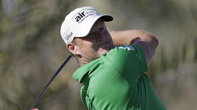 Jamie Donaldson from Wales follows his ball on the 14th hole ball on the 10th hole during the third round of Abu Dhabi Golf Championship in Abu Dhabi, United Arab Emirates, Saturday, Jan. 19, 2013. (AP Photo/Kamran Jebreili)