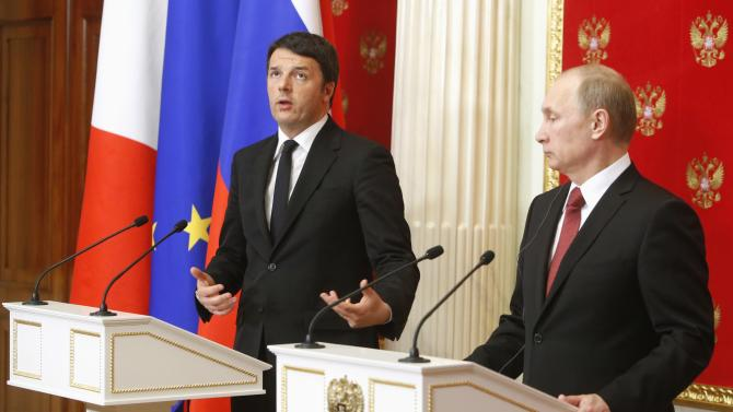Italian Prime Minister Matteo Renzi speaks during a news conference with Russian President Vladimir Putin following their meeting at the Kremlin in Moscow