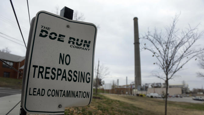 "In this Nov. 15, 2013 photo, a ""No Trespassing"" sign is seen outside Doe Run Co.'s lead smelter in Herculaneum, Mo. The nation's only primary lead smelter and the unquestioned center of the tiny town 25 miles south of St. Louis, is shutting down for good, its operator citing rising regulatory costs. Despite the environmental and health concerns that include high levels of lead in the blood of some children and yards so toxic the soil had to be removed, many in the small town are saddened by the end of an era. (AP Photo/Jeff Roberson)"