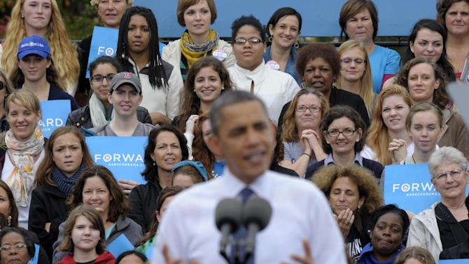 FILE - This Oct. 19, 2012 file photo shows thee audience, who were mostly women, listen behind President Barack Obama as he speaks about the choice facing women in the election during a campaign event at George Mason University in Fairfax, Va. Sorry, fellas, but President Barack Obama's re-election makes it official: Women can overrule men at the ballot box. For the first time in research dating to 1952, the candidate whom the most men chose _ Mitt Romney _ lost. More women voted for the other guy.  It's surprising it didn't happen sooner, since women have been voting in larger numbers than men for almost three decades, exit polls show.  (AP Photo/Susan Walsh, File)