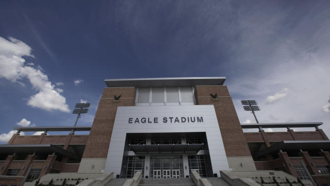 FILE - This Aug. 28, 2012 file photo shows the front entrance of Eagle Stadium at Allen High School in Allen, Texas. The $60 million high school football stadium that opened to massive fanfare in 2012 will be shut down for the upcoming season after cracks were found in the building's concrete concourse. (AP Photo/LM Otero, File)