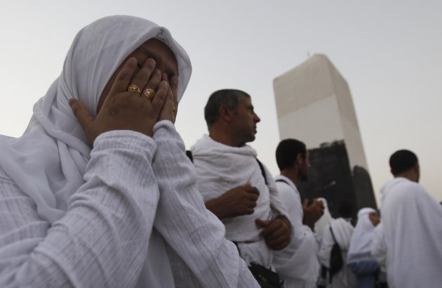 A Muslim pilgrim prays near …