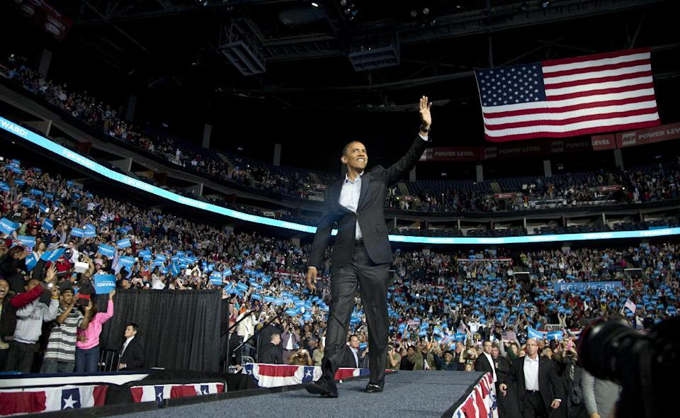 President Barack Obama waves to supporters as he arrives to speaks at a campaign event at Nationwide Arena, Monday, Nov. 5, 2012, in Columbus, Ohio.  (AP Photo/Carolyn Kaster)