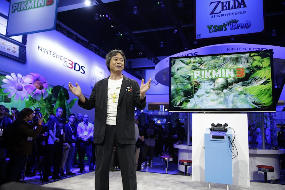 Shigeru Miyamoto, a Japanese video game designer, introduces the Pikmin 3 at the Nintendo Wii U software showcase during the E3 game show in Los Angeles, Tuesday, June 11, 2013. (AP Photo/Jae C. Hong)