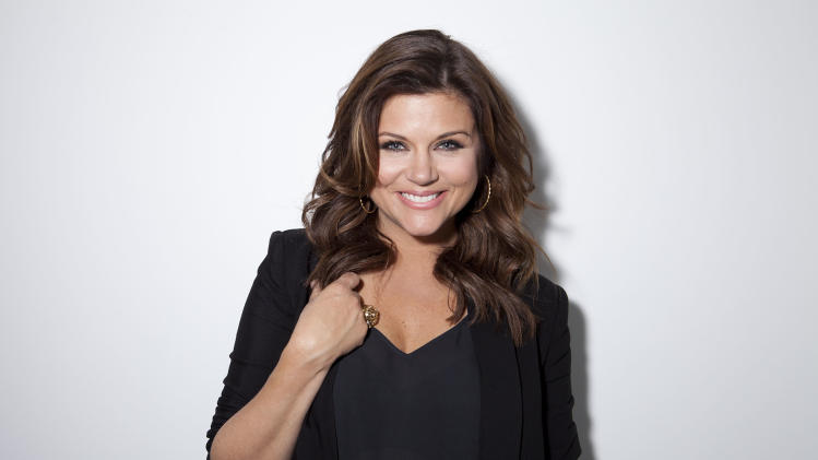 "This Feb. 6, 2013 file photo shows actress Tiffani Thiessen posing for a portrait in New York. Thiessen, best known for her former role as Kelly Kapowski on TV's ""Saved by the Bell,"" says she had no idea at the time of how popular the show was. She says she's grateful she grew up in the limelight before TMZ and other 24 hour media outlets and gossip blogs came along. She currently stars in the USA series ""White Collar."" (Photo by Amy Sussman/Invision/AP)"