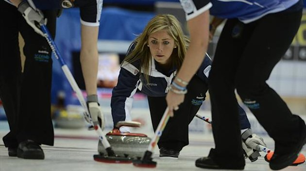 Scotland's Eve Muirhead (C) delivers a shot during their European Curling Championship semi-final match against Sweden in Karlstad