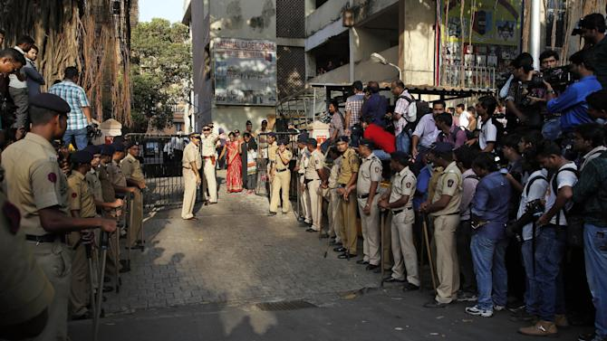 Indian policemen guard outside the Mumbai Sessions court during Bollywood actor Salman Khan's verdict in Mumbai, India, Wednesday, May 6, 2015. One of India's biggest and most popular movie stars, Khan, was sentenced to five years in jail Wednesday on charges of driving a vehicle over five men sleeping on a sidewalk and killing one in a hit-and-run case that has dragged for more than 12 years. (AP Photo/Rajanish Kakade)