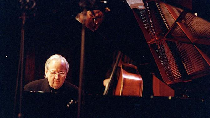 FILE - In this Oct. 15, 2000 file photo, conductor, composer and pianist Andre Previn performs at the Jazz Standard club in New York. Andre Previn's opera version of ``A Streetcar Named Desire'' finally made it to New York, 15 years after its world premiere. Previn's adaptation of the Tennessee Williams play, with a libretto by Philip Littell, returned on Thursday night, March 14, 2013, for a semi-staged concert performance at Carnegie Hall with Renee Fleming, who sang Blanche Dubois at the San Francisco Opera's world premiere production. (AP Photo/Jim Cooper, File)