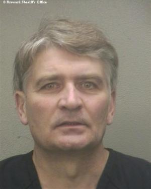 Former UBS banker Raoul Weil is seen in a booking photo after his arrival at the Broward Sheriff's Office in Fort Lauderdale