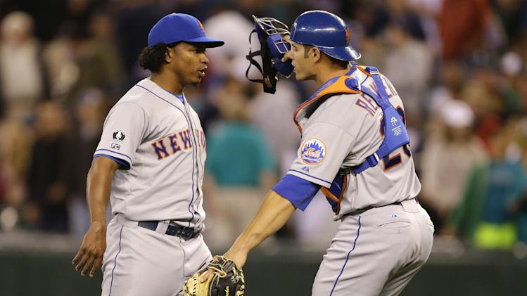 New York Mets closing pitcher Jenrry Mejia, left, moves to hug catcher Anthony Recker, right, after they defeated the Seattle Mariners 3-2 in a baseball game on Wednesday, July 23, 2014, in Seattle. (AP Photo)