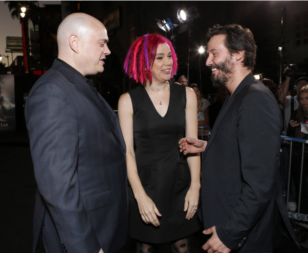Andy Wachowski, Lana Wachowski and Keanu Reeves arrive at the Los Angeles premiere of 'Cloud Atlas' at Grauman's Chinese Theatre on October 24, 2012 in Hollywood, California.  (Photo by Todd Williamso
