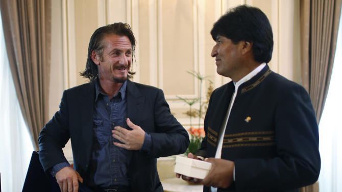 Bolivia's President Evo Morales, right, listens to U.S. actor Sean Penn in the presence of the media as they meet at the government palace in La Paz, Bolivia, Tuesday, Oct. 30, 2012. (AP Photo/Juan Karita)