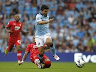 Manchester City striker Sergio Aguero (front) during their English Premier League match against Southampton in August. Manager Roberto Mancini insists Aguero has a chance of featuring against Real despite the Argentina international struggling to recover from an ankle problem