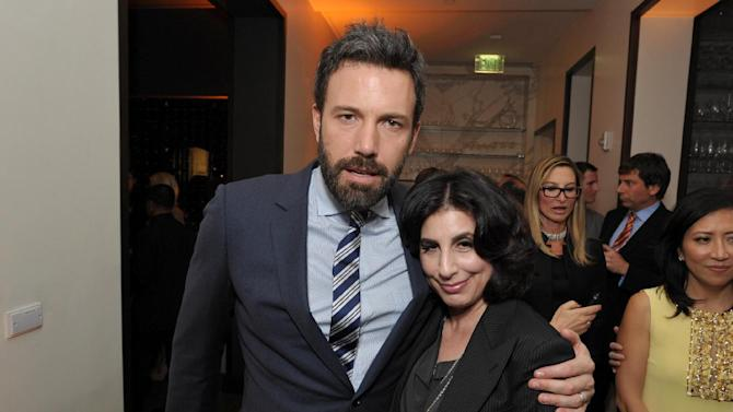 Ben Affleck, left, and Sue Kroll, president of worldwide marketing at Warner Bros., attend The Hollywood Reporter Nominees' Night at Spago on Monday, Feb. 4, 2013, in Beverly Hills, Calif. (Photo by John Shearer/Invision for The Hollywood Reporter/AP Images)