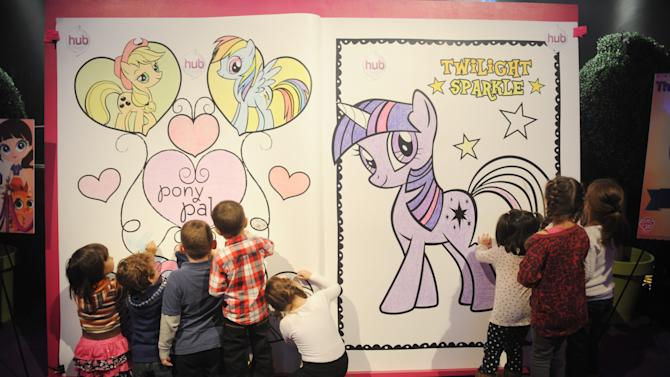 Children color on The My Little Pony Coloring Book at The Hub's Playdate Premiere Party on Saturday, Nov. 10, 2012 in New York. (Photo by Scott Gries/Invision for The Hub/AP Images)