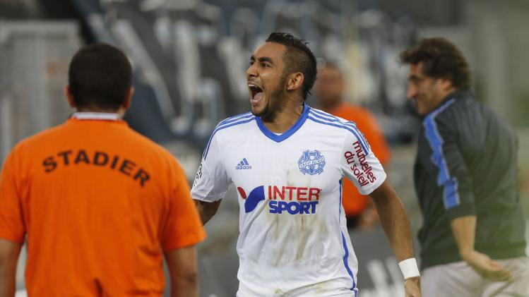 Olympique Marseille's Payet celebrates after his second goal against Nice during their French Ligue 1 soccer match at the Velodrome Stadium in Marseille