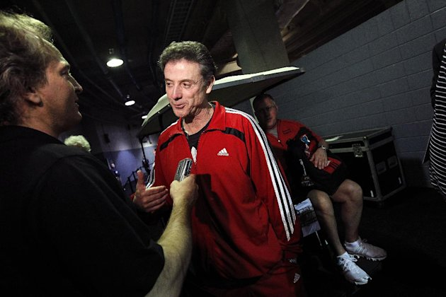 Louisville head coach Rick Pitino talks to reporters after a news conference in New Orleans, Thursday, March 29, 2012. Louisville will play Kentucky in an NCAA tournament Final Four semifinal college basketball game on Saturday. (AP Photo/Gerald Herbert)