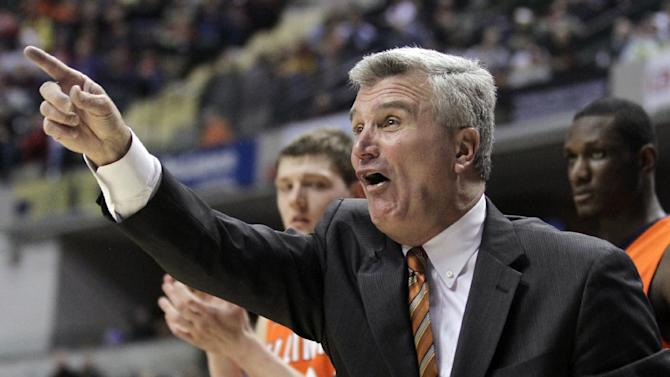 FILE - In this March 8, 2012, file photo, Illinois head coach Bruce Weber reacts during the first half of an NCAA college basketball game against Iowa in the first round of the Big Ten Conference tournament in Indianapolis. A person familiar with the situation says Weber has been hired by Kansas State to replace men's basketball coach Frank Martin, who left for South Carolina. (AP Photo/Michael Conroy, File)