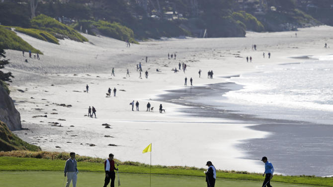 Roberto Castro, right, walks to his ball on the tenth green of the Pebble Beach Golf Links during a practice round of the AT&T Pebble Beach Pro-Am golf tournament  Wednesday, Feb. 6, 2013 in Pebble Beach, Calif. (AP Photo/Eric Risberg)
