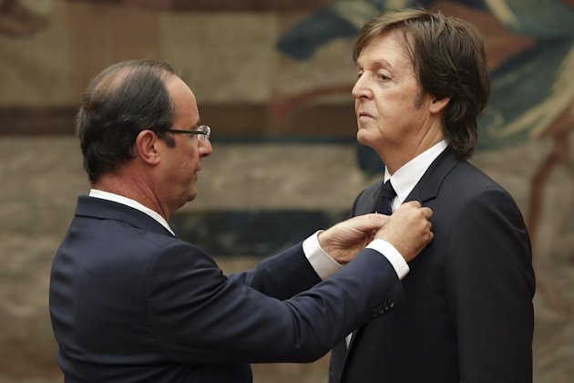 French President Francois Hollande, left, awards British musician Paul McCartney during a decoration ceremony photo session at the Elysee Palace in Paris, Saturday, Sept. 8, 2012. Hollande decorated the former Beatle with a Legion of Honor award, France's highest public distinction which has been awarded to the likes of actor Clint Eastwood and singer Liza Minnelli and Barbara Streisand. (AP Photo/ Philippe Wojazer, Pool)