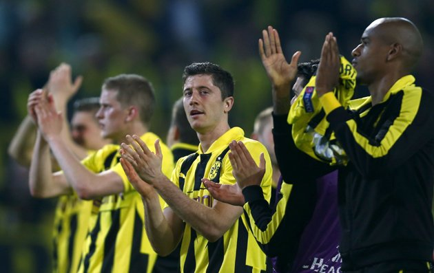 Borussia Dortmund's Robert Lewandowski (C) and his team-mates celebrate after defeating Real Madrid in the Champions League semi-final first leg at BVB stadium (Reuters)