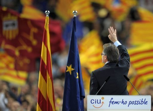 <p>Artur Mas, leader of Spain's Catalonia region, waves at supporters at the end of a final meeting for his re-election campaign. Mas vowed on Friday to fight for the 'future of our nation' before a roaring crowd of supporters, ahead of weekend elections that could lead to a popular demand for statehood.</p>