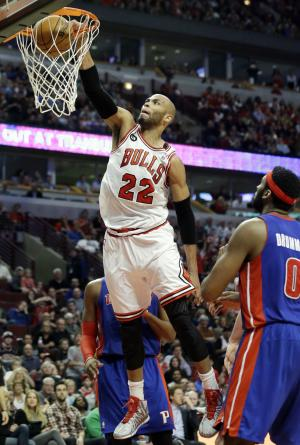 Chicago Bulls forward Taj Gibson (22) dunks against …
