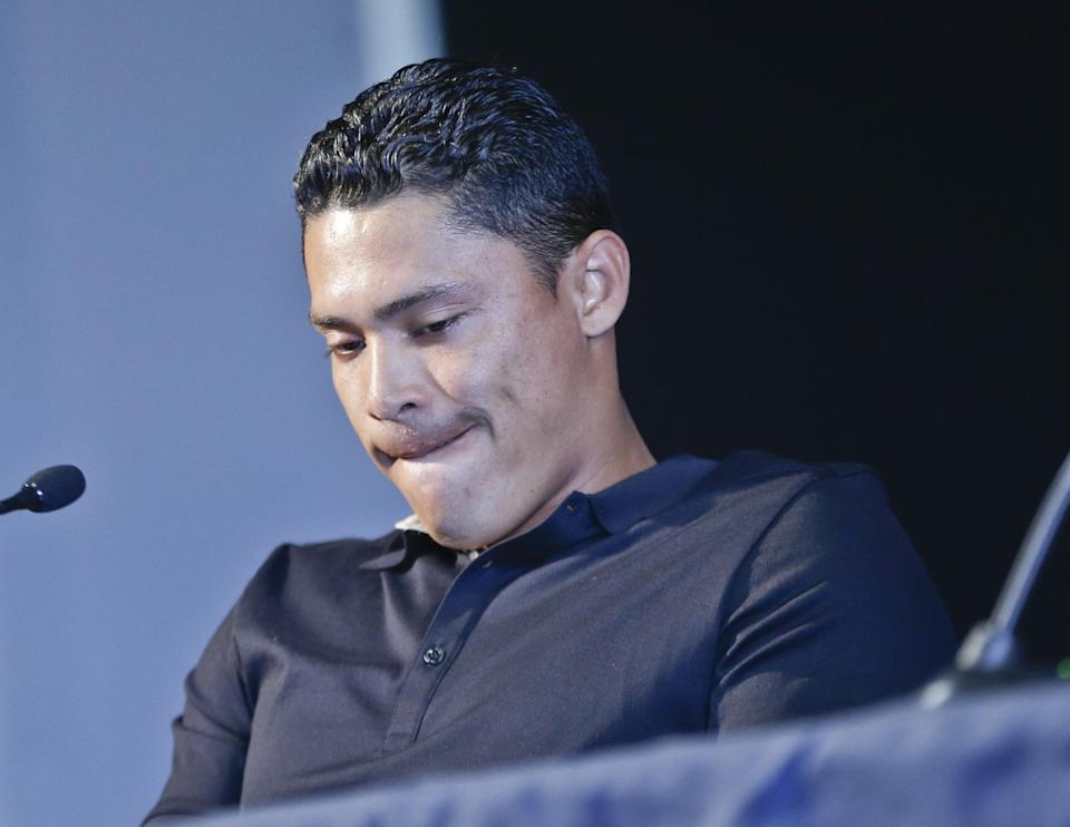 San Diego Padres shortstop Everth Cabrera, who was suspended by Major League Baseball for 50 games, tries to gather his emotions during a news conference in San Diego, Monday, Aug. 5, 2013. (AP Photo/Lenny Ignelzi)