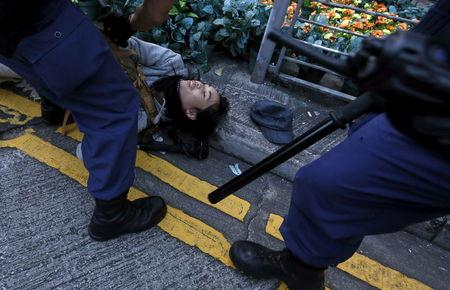 Riot police arrests a protester after a clash at Mongkok district in Hong Kong, China