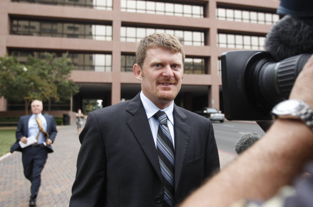 Former cyclist Floyd Landis leave federal court, Friday, Aug. 24, 2012 in San Diego. Landis agreed Friday to a deal with prosecutors who agreed to defer prosecution on wire fraud charges on condition he makes restitution to people from whom he raised money to fund his fight against doping charges. (AP Photo/Lenny Ignelzi)
