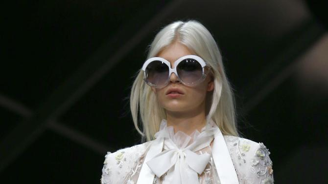 A model presents a creation from the Roberto Cavalli Spring/Summer 2015 collection during Milan Fashion week