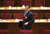 Bo Xilai attends a National People&#39;s Congress session at the Great Hall of the People in Beijing, March 9, 2012. As Chongqing boss and member of the elite Politburo, Bo stood out for his suave and open demeanour, seen as refreshing among China&#39;s rigid leadership. But his signature ideological and anti-mafia campaigns drew both hero-worship and accusations of serious abuses