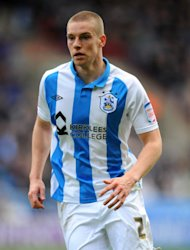 Calum Woods has agreed a new deal with Huddersfield