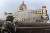 An Indian soldier aims his rifle at the Taj Mahal hotel during the deadly 2008 Mumbai attacks. A total of 166 people were killed in the attacks when Islamist gunmen stormed luxury hotels, a Jewish centre, a hospital and a bustling train station. The lone surviving gunman from the 2008 Mumbai attacks has applied for clemency from the Indian president in a final bid to avoid the gallows