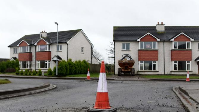 A traffic cone marks a raised manhole cover on the Glenall housing estate in the village of Borris-in-Ossory, County Laois