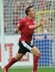 Freiburg&#39;s midfielder Max Kruse celebrates scoring during their German first division Bundesliga football match against Mainz 05 in Freiburg, southwestern Germany. The match ended in a 1-1 draw